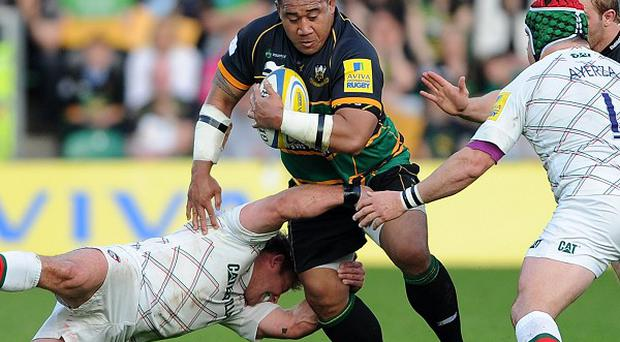 Northampton Saints Salesi Ma'afu is tackled by the Leicester Tigers during the Aviva Premiership Play-off, Semi Final match at Franklins Gardens, Northampton.