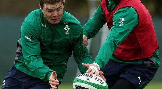 Robbie Henshaw, right, will have to wait to stake his claim to replace Brian O'Driscoll, left, in the Ireland side