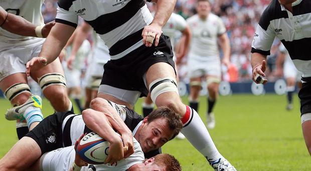 Henry Slade, centre, stretches home for his try in the England XV's 39-29 loss to the Barbarians