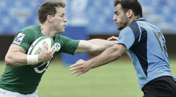 On the attack: Ireland's Craig Gilroy aims to make ground