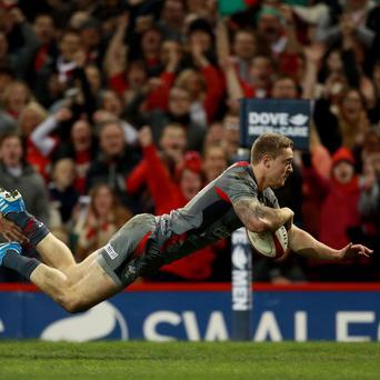 Cardiff Blues centre Owen Williams scores a try for Wales against Tonga last season