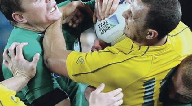 Choker: Australia's Rocky Elsom struggles to escape from a choke tackle during Ireland's 15-6 victory in the last Rugby World Cup