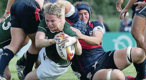 Take that: Ireland's Niamh Briggs scores a try during their opening World Cup victory over USA