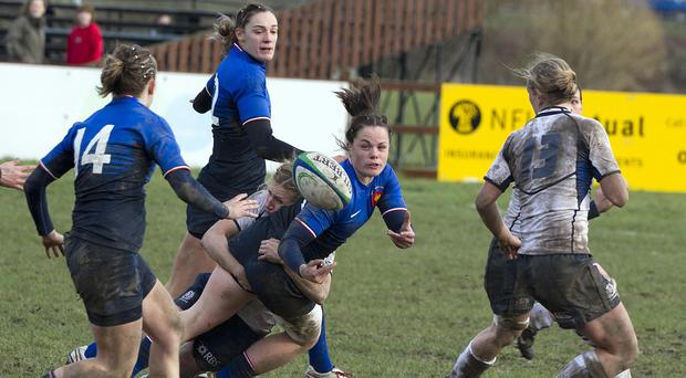 Elodie Poublan, centre, went over for France