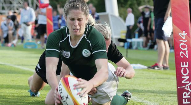 Touching over: Alison Miller crosses the whitewash in Marcoussis to add to Ireland's tally against New Zealand