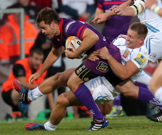 Ready to rumble: Ulster's Louis Ludik is tackled by Exeter's Sam Hill