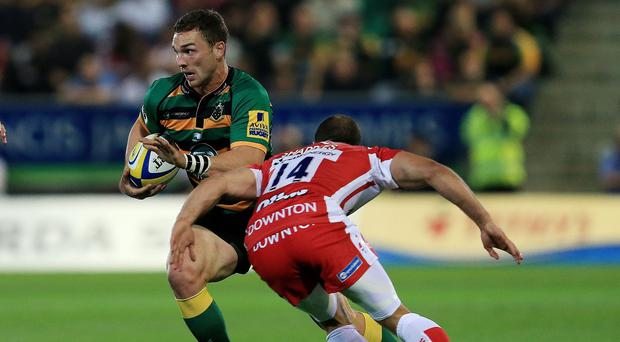 George North, left, scored a hat-trick for Saints