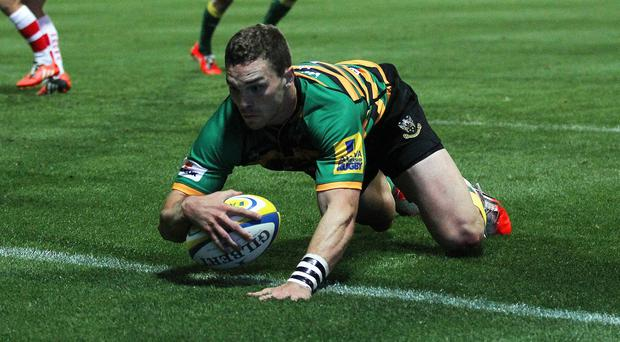 George North scored a hat-trick in Northampton's demolition of Gloucester