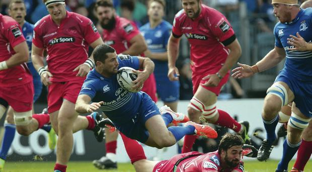 Star turn: Rob Kearney returned to the Leinster side and scored two tries in their 42-12 annihilation of the Scarlets