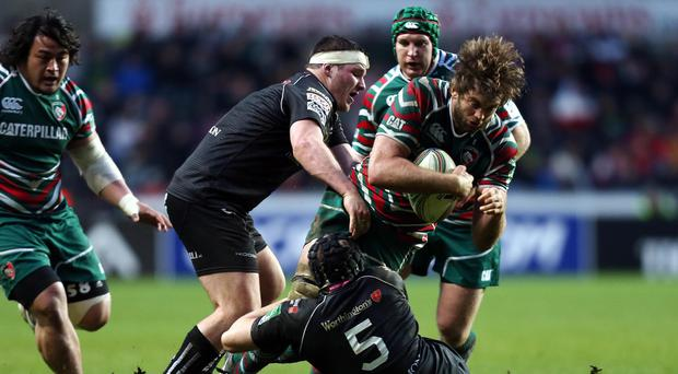 Wales prop Ryan Bevington (with headband) in action for the Ospreys
