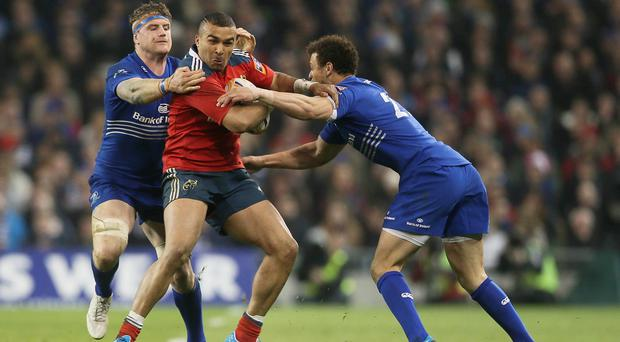 Munster's Simon Zebo, centre, ran in three first half tries