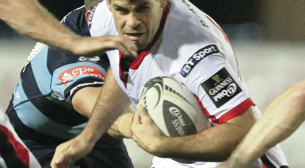 Doubling up: It takes both Gareth Davies and Gavin Evans to stop Ulster ace Louis Ludik in Cardiff