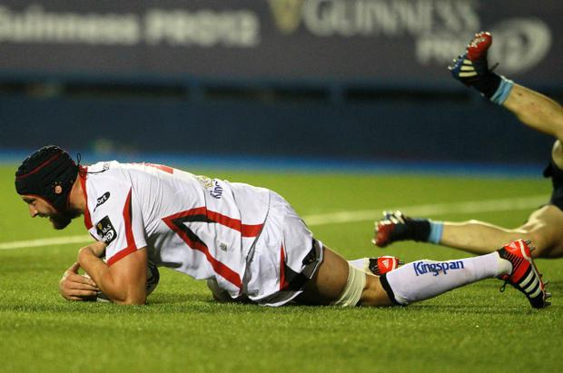 Down and then out: Dan Tuohy scores a try for Ulster against Cardiff but then sustained a broken arm
