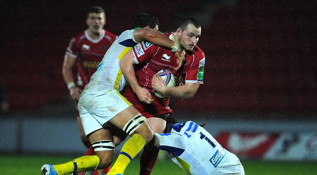 Scarlets and Wales hooker Ken Owens, right, has undergone tests on a neck injury