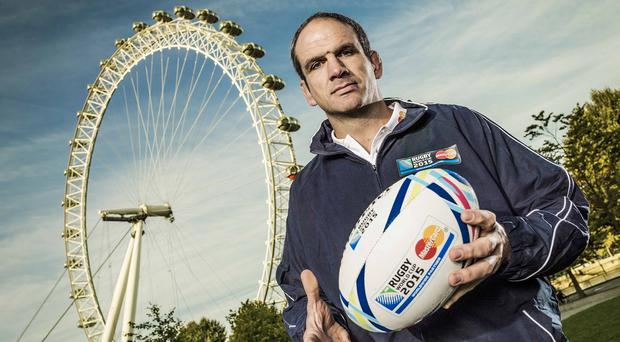 Martin Johnson poses alongside the London Eye as he is unveiled as a MasterCard ambassador for Rugby World Cup 2015. MasterCard is the Preferred Card and Official Payment System of the Rugby World Cup 2015