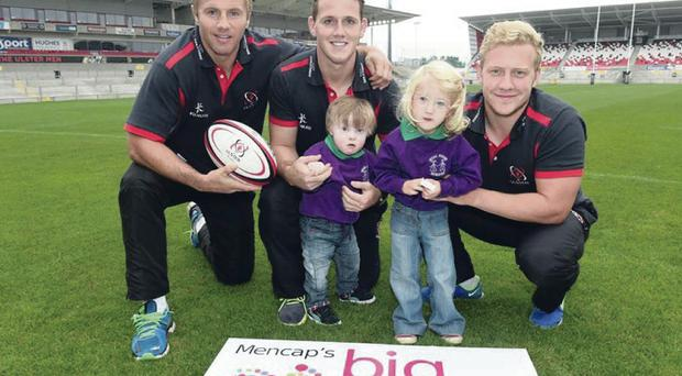 Big support: Roger Wilson, Craig Gilroy, and Stuart Olding with James Green and Imiani Frost, two children attending Segal House Nursery, as Ulster Rugby backs Mencap's Big Step Forward Appeal