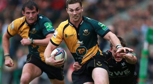 Canadian winger Jeff Hassler (right, tackling) has signed a new deal with Ospreys