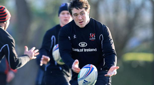 Raring to go: Ulster's Declan Fitzpatrick gets tuned up yesterday for tonight's big game at home to the Dragons