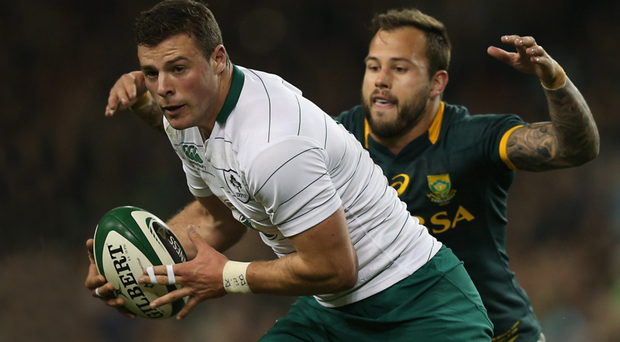 Right behind you: Robbie Henshaw is tackled by Springboks' Francois Hougaard