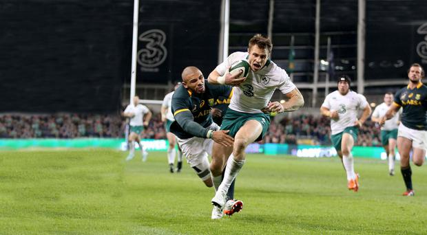 Game winner: Tommy Bowe marked his return to the Ireland team by scoring his side's second try in the 29-15 victory over South Africa