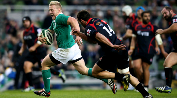 No stopping me: Stuart Olding breaks free to score Ireland's sixth try