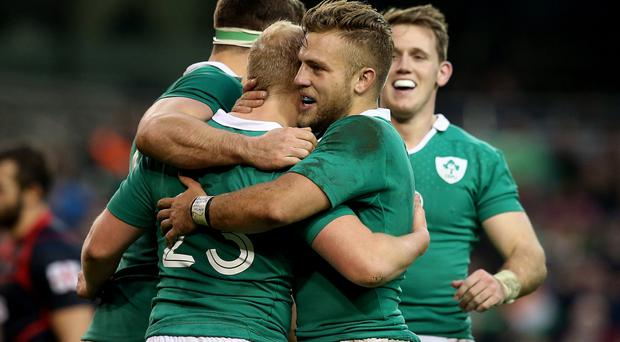 You beauty: Ian Madigan joins in the celebrations after Stuart Olding's try against Georgia