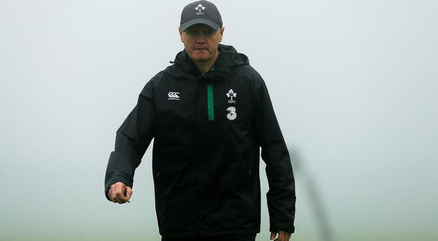Joe Schmidt, pictures, is hoping to see Chris Henry back playing rugby soon