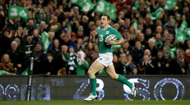 Ireland's Tommy Bowe on the way to scoring his side's second try