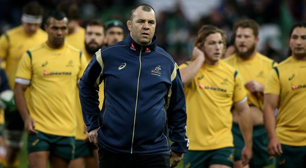Coach Michael Cheika, centre, has challenged Australia to toughen up