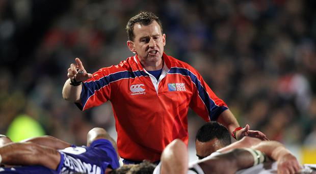 Two men found guilty of abusing referee Nigel Owens, pictured, have been given two-year Twickenham bans