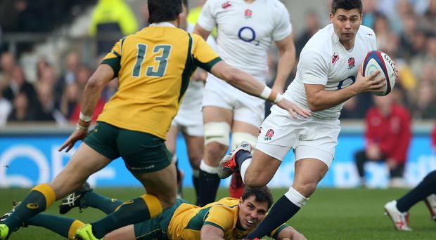 England's Ben Youngs ,right, is tackled by Australia's Adam Ashley-Cooper
