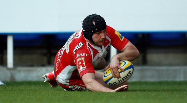 Gloucester's Steve McColl crosses to put the seal on Gloucester's victory