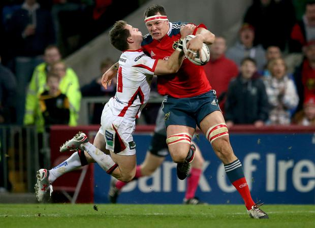 Crunch time: Ulster's Craig Gilroy battles for the ball with Robin Copeland of Munster on Friday night