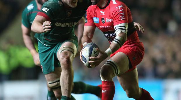 Tigers show teeth: Sebastien Tillous-Borde of Toulon is tackled by Jamie Gibson at Welford Road yesterday