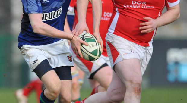 That man again: Damon Hall scored a try against Dungannon as Queen's ran out comfortable winners in the Ulster Senior League