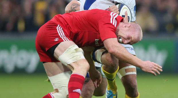 No way through: Alexandre Lapandry of Clermont is tackled by Paul O'Connell during the match at Stade Marcel Miche