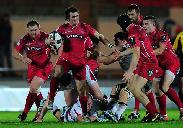 On the move: Rhodri Williams of Scarlets makes a break during the game