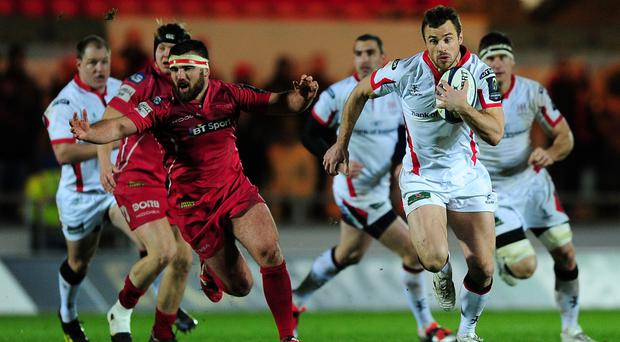 Making a charge: Tommy Bowe tries to breach Scarlets' defence