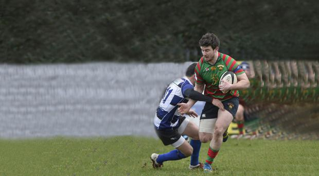 Running ahead: Donaghadee's Adam Alexander breaks through the CIYMS defence at Belmont
