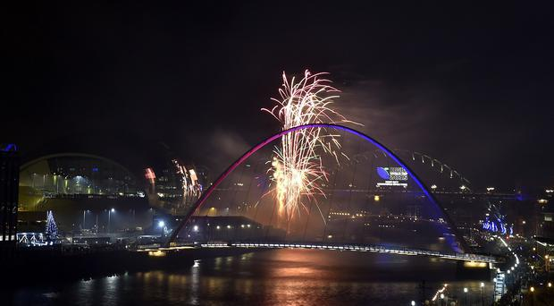 Stuart Lancaster was at a firework display in Newcastle marking the turning of the year by unveiling a Rugby World Cup mark on the Tyne Bridge