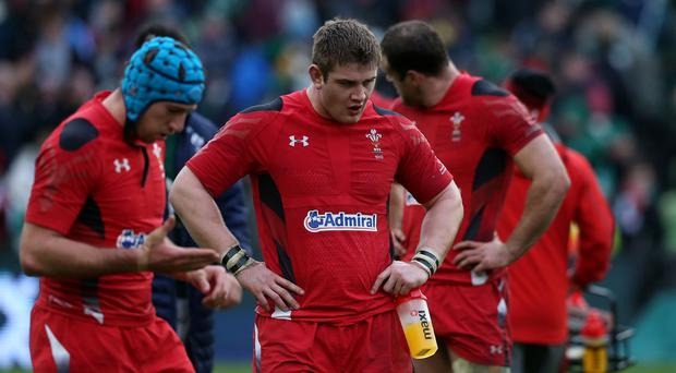 Scarlets and Wales prop Rhodri Jones, centre, is a doubt for the RBS 6 Nations