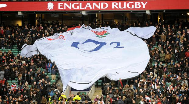 England fans pass a giant replica shirt across the stands at Twickenham