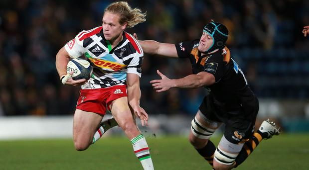 Matt Hopper, with the ball in his hand, is staying with Harlequins