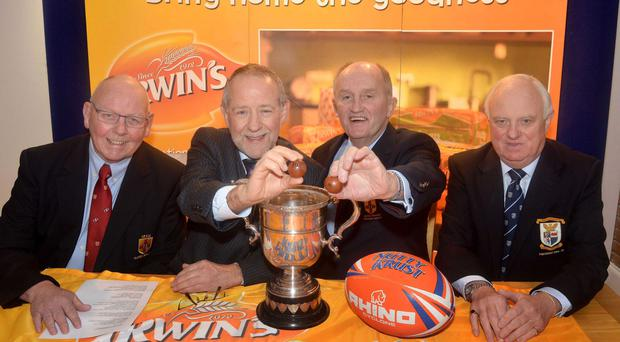 Slice of the action: Pictured at the draw for the 2015 Nutty Krust Rugby Floodlit Tournament are from left Bobby Stewart, Ulster Branch Senior Vice President, Brian Irwin, Irwin's Bakery (Sponsor), John Kinnear, President, Ulster Branch IRFU and Mark Crozier, President Portadown RFC
