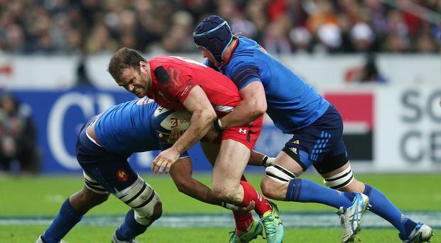 Wales centre Jamie Roberts, centre, in action against France during this season's RBS 6 Nations Championship