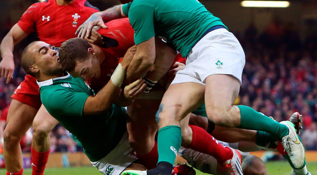 Doubling up: Ireland's Simon Zebo and Rob Kearney stop Wales ace George North at the Millennium Stadium