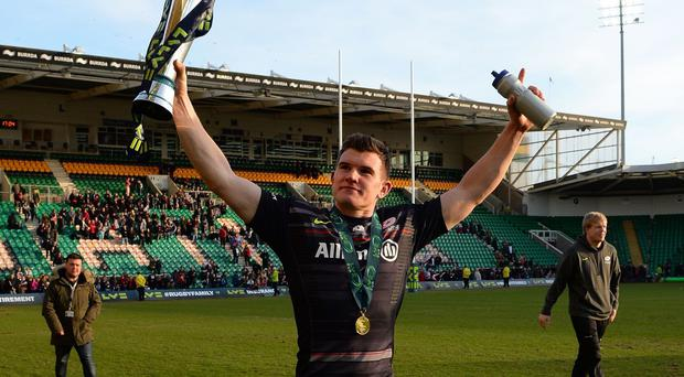 Saracens' Ben Spencer, pictured, celebrates with the LV= Cup trophy after the final victory over Exeter on Sunday