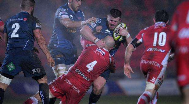 Scarlets prop Rob Evans, centre, has signed a new contract with the club