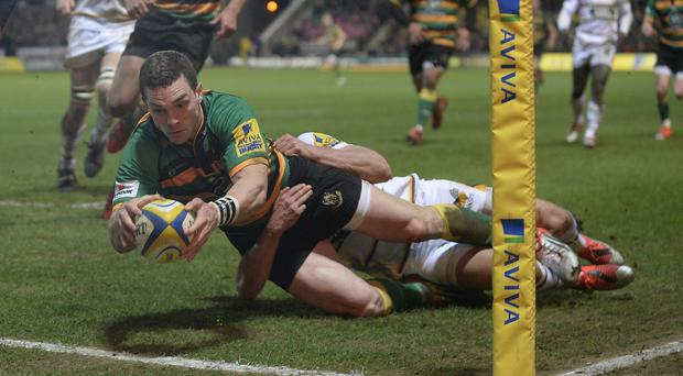George North scored two tries before going off with a head injury