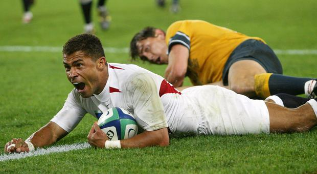 Jason Robinson celebrates scoring his try for England against Australia during the World Cup final